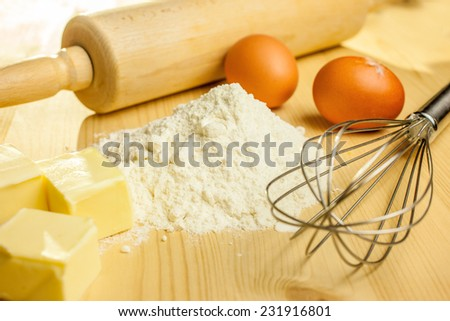 Ingredients and utensils for baking - stock photo