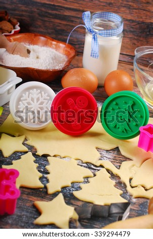 ingredients and utensils for baking christmas cookies on rustic wooden table - stock photo