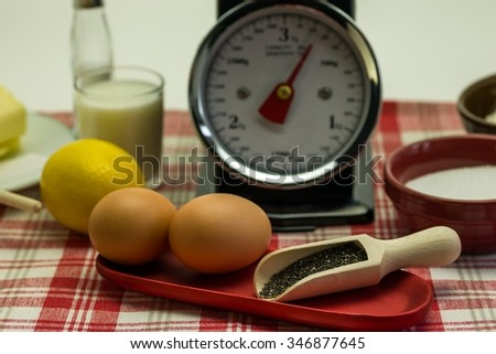 Ingredients for a cake - Eggs, lemon, butter, baking powder and flour