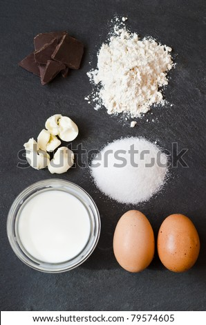 Ingredients for a cake on a black natural stone - stock photo
