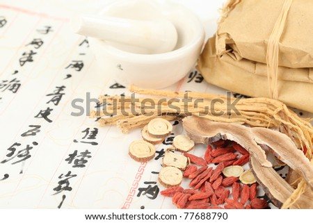 Ingredients for a Chinese medicine formula - Chinese characters are names for the herbs in the formula - stock photo