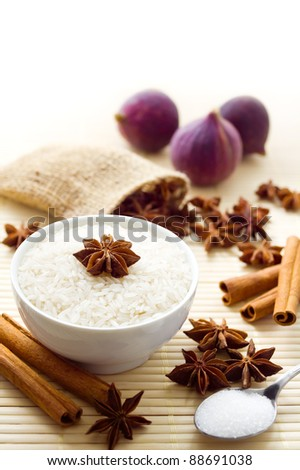 Ingredients for a sweet rice pudding. Rice is uncooked - stock photo