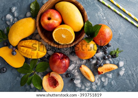 Ingredients for a tropical fruit smoothie with mango and citrus - stock photo