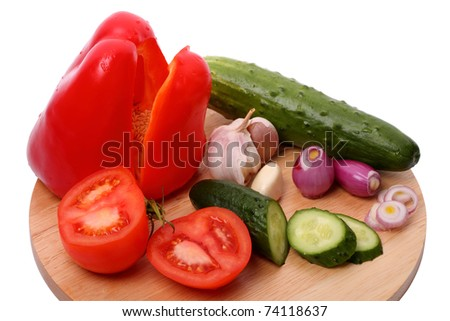 Ingredients for a vegetable salad on a cutting board