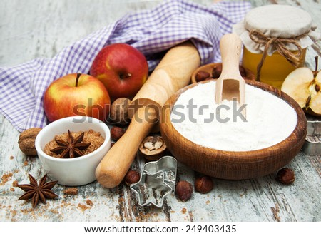ingredients for apple pie - red apple, butter, flour, brown sugar, nuts and spices - stock photo