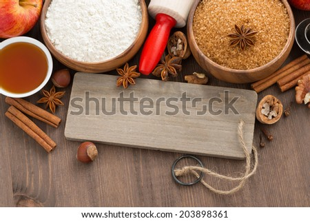 ingredients for baking apple pie and a wooden nameplate, close-up, top view, horizontal - stock photo