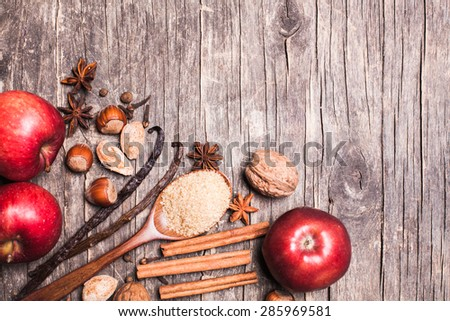 Ingredients for baking apple pie - nuts and spices - stock photo