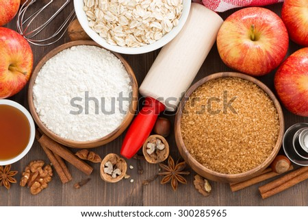 ingredients for baking cake on a wooden background, close-up, top view, horizontal - stock photo
