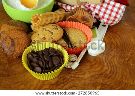 ingredients for baking desserts cookies, muffins, waffles on a wooden table - stock photo
