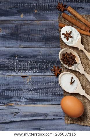 Ingredients for baking - egg, flour, sugar, anise, cinnamon. Selective focus - stock photo