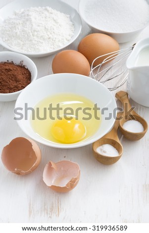 ingredients for baking on a white wooden table, vertical, top view, close-up