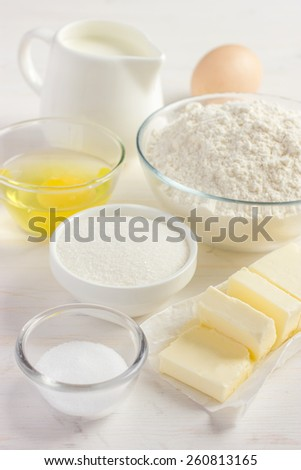 Ingredients for baking on the white wooden table - stock photo