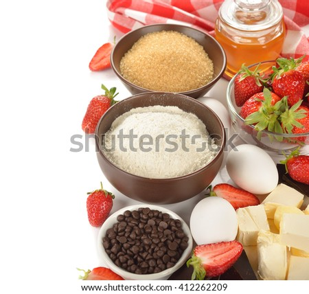 Ingredients for baking strawberries cake on a white background - stock photo