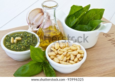 Ingredients for basil pesto with pinenuts - stock photo