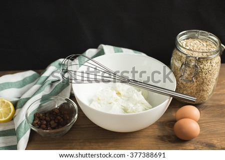 Ingredients for cheese casseroles, oatmeal, cottage cheese, eggs and raisins