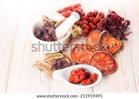 Ingredients for Chinese herbal soup on wood background  - stock photo