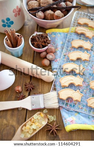 Ingredients for Christmas bakery and star-shaped cookies - stock photo