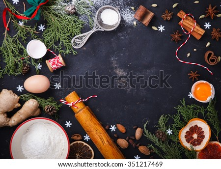 Ingredients for Christmas baking , flour, cinnamon, star anise, ginger,  top view,star anise,eggs,cardamom.Copy space.selective focus. - stock photo
