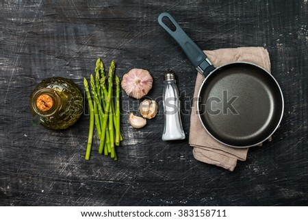 Ingredients for cooking asparagus on a black background, top view - stock photo