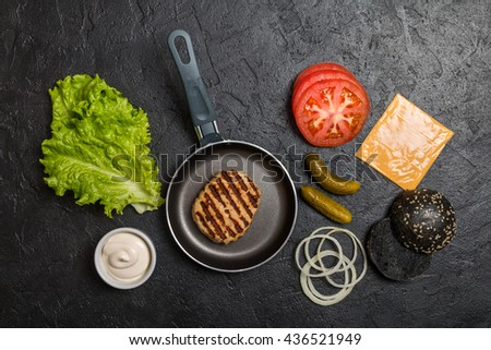 Ingredients for cooking black burger.  - stock photo