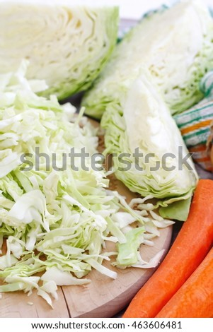 Ingredients for cooking. Fresh cabbage and other vegetables on the table.