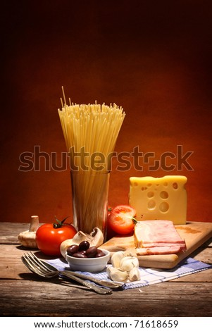 Ingredients for cooking italian pasta close up - stock photo