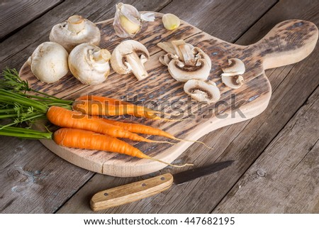 Ingredients for cooking: mushrooms, carrots and garlic. Closeup - stock photo