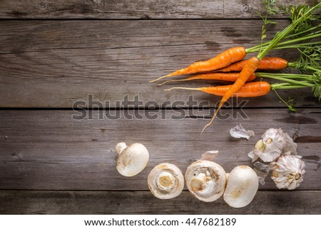 Ingredients for cooking: mushrooms, carrots and garlic. Top view - stock photo