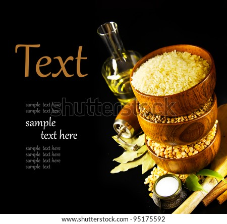 Ingredients for cooking on a black background  (With sample text) - stock photo