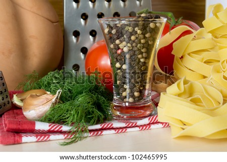 Ingredients for cooking pasta with tomatoes and herbs - stock photo