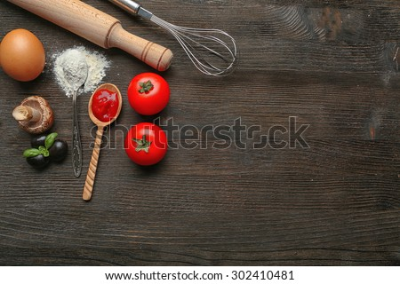 Ingredients for cooking pizza on wooden table, top view - stock photo