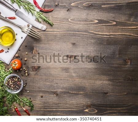 ingredients for cooking vegetarian food, tomatoes, butter, herbs, colorful peppers on wooden rustic background top view border, place for text  - stock photo