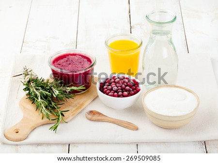 Ingredients for Cranberry and rosemary lemonade, cocktail, fizz on a white wooden background - stock photo