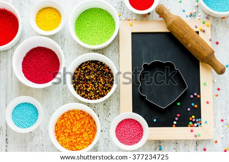 Ingredients for decoration festive cakes and pastries on white background, top view with copy space - stock photo