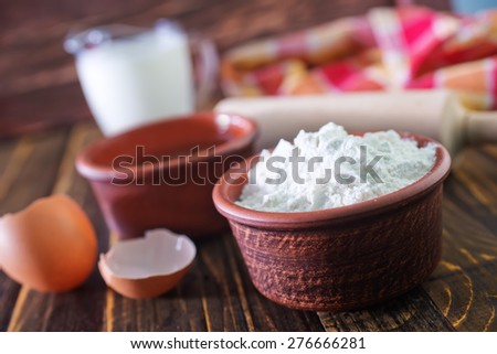 ingredients for dough on the wooden table - stock photo