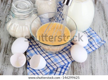 Ingredients for dough on wooden table close-up - stock photo