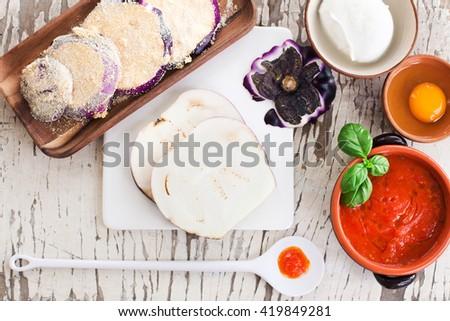 ingredients for eggplant parmigiana - stock photo
