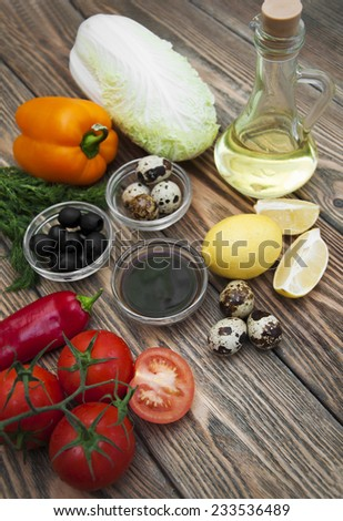 Ingredients for fresh salad on a wooden background