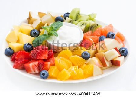 ingredients for fruit salad and natural yoghurt, closeup, horizontal - stock photo