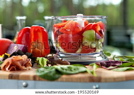 Ingredients for gazpacho cold soup in a blender, outdoors - stock photo