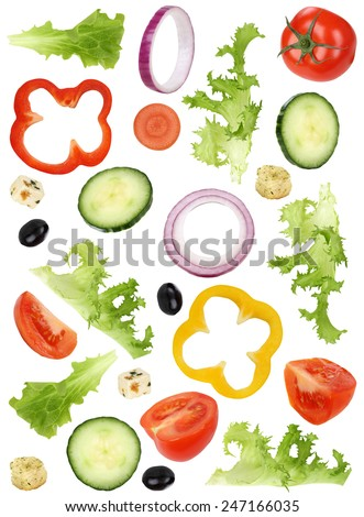Ingredients for green salad with tomatoes, Feta cheese, onion, olives and cucumber - stock photo