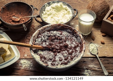 Ingredients for homemade chocolate with nuts - stock photo