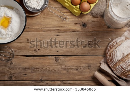 Ingredients for homemade dough (butter, egg, milk , flour). Ingredients for bakery products. Top view. Copy space. Free space for object - stock photo
