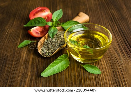 Ingredients for Italian food: basil , tomatoes and olive oil - stock photo