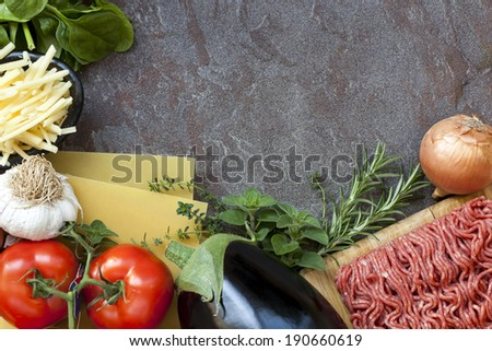 Ingredients for lasagna, over dark slate background. - stock photo