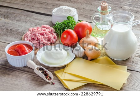 Ingredients for lasagne on the wooden background - stock photo