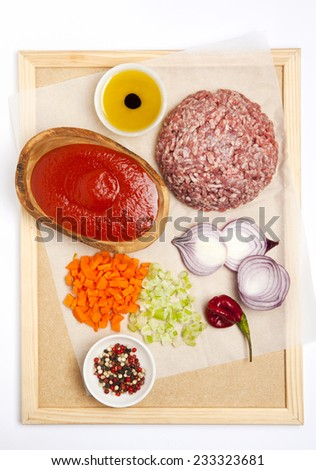 ingredients for make meat sauce bolognese: mince meat , tomato sauce, red onion, carrot, olive oil, red peppers.  - stock photo