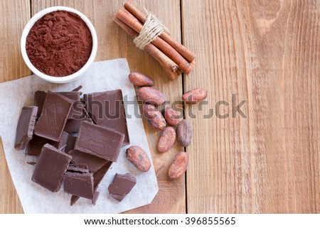 Ingredients for making chocolate chip cookies on a wooden background . cocoa , cinnamon. Close up. Top view - stock photo