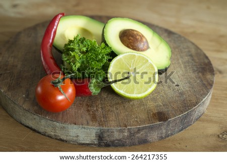 ingredients for making guacamole, shallow DOF - stock photo
