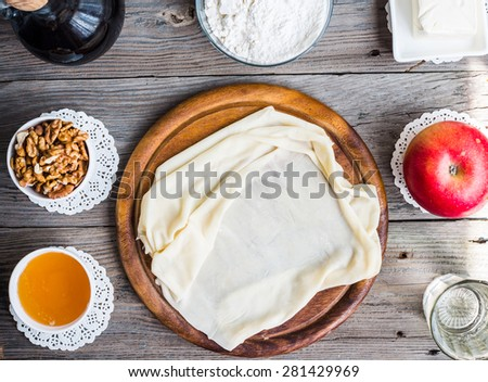 Ingredients for making homemade apple strudel,phyllo dough, nuts, honey, apple? sweet - stock photo